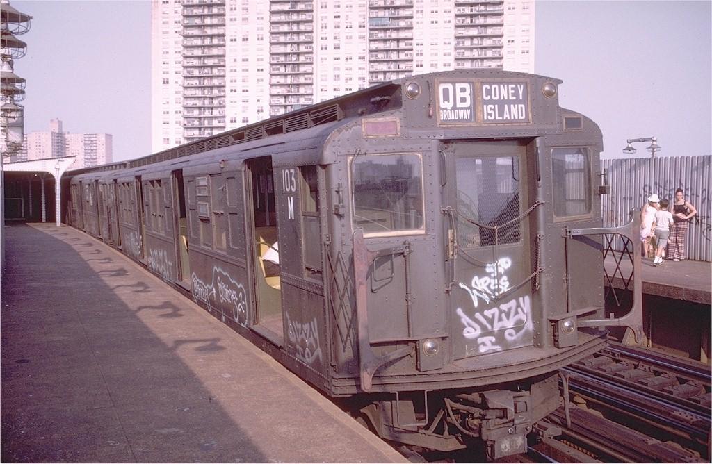 (217k, 1024x668)<br><b>Country:</b> United States<br><b>City:</b> New York<br><b>System:</b> New York City Transit<br><b>Line:</b> BMT Brighton Line<br><b>Location:</b> West 8th Street <br><b>Route:</b> QB<br><b>Car:</b> R-1 (American Car & Foundry, 1930-1931) 103 <br><b>Photo by:</b> Doug Grotjahn<br><b>Collection of:</b> Joe Testagrose<br><b>Date:</b> 7/30/1973<br><b>Viewed (this week/total):</b> 1 / 6435