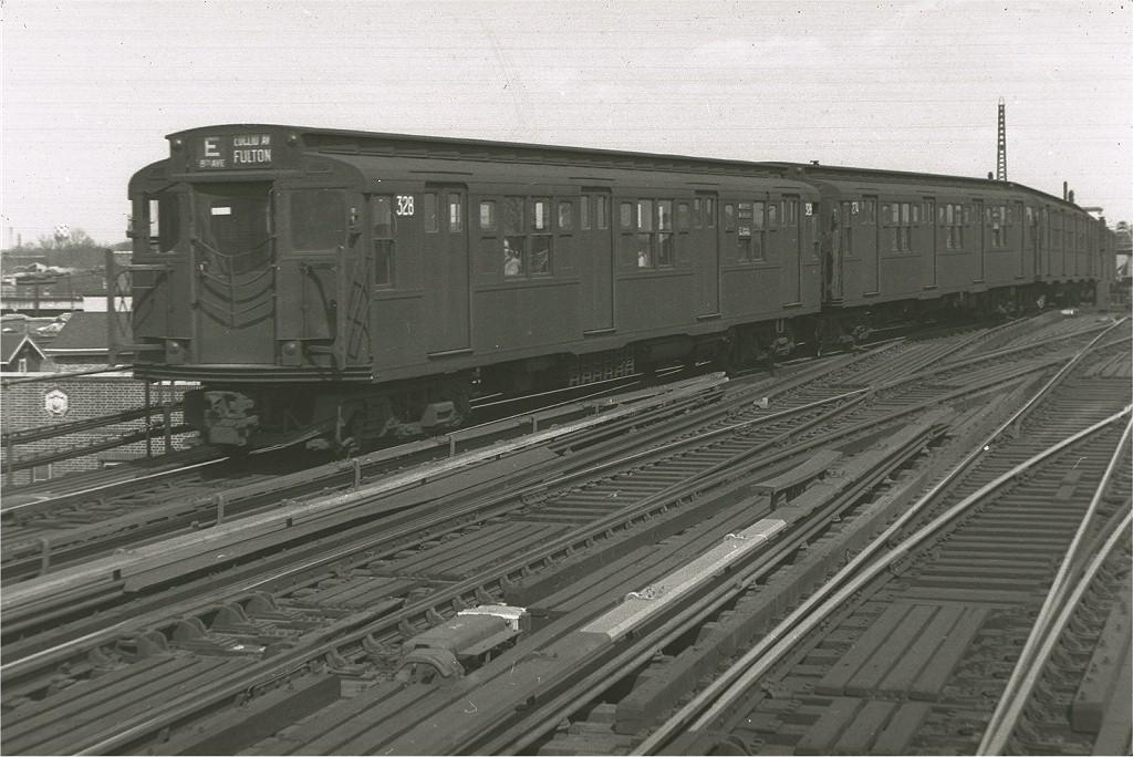 (197k, 1024x684)<br><b>Country:</b> United States<br><b>City:</b> New York<br><b>System:</b> New York City Transit<br><b>Line:</b> IND Fulton Street Line<br><b>Location:</b> Rockaway Boulevard <br><b>Route:</b> E<br><b>Car:</b> R-1 (American Car & Foundry, 1930-1931) 328 <br><b>Photo by:</b> Harry Pinsker<br><b>Date:</b> 4/10/1960<br><b>Viewed (this week/total):</b> 3 / 4555
