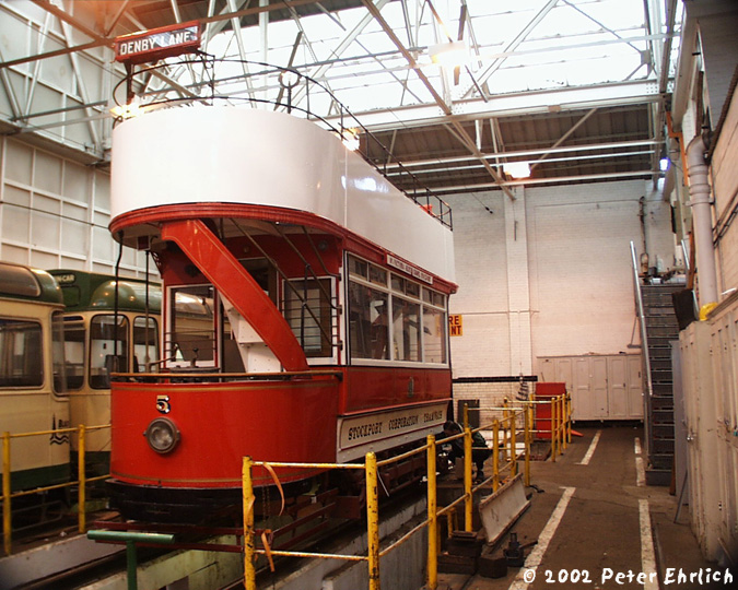 (184k, 675x540)<br><b>Country:</b> United Kingdom<br><b>City:</b> Blackpool<br><b>System:</b> Blackpool Transport<br><b>Location:</b> Rigby Road Depot<br><b>Car:</b> Blackpool Tram 5 <br><b>Photo by:</b> Peter Ehrlich<br><b>Date:</b> 6/30/2002<br><b>Notes:</b> Stockport 5 was built in 1901, and is an example of the classic double-deck open-end car of that era.  Rigby Road Depot.<br><b>Viewed (this week/total):</b> 0 / 2726