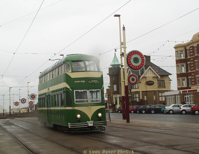 (134k, 697x540)<br><b>Country:</b> United Kingdom<br><b>City:</b> Blackpool<br><b>System:</b> Blackpool Transport<br><b>Car:</b> Blackpool Balloon (English Electric, 1934-1935)  700 <br><b>Photo by:</b> Peter Ehrlich<br><b>Date:</b> 6/30/2002<br><b>Notes:</b> Balloon 700 has been restored to its original 1934 appearance complete with original number 237 affixed near its door.  Also, it has its lower-window vents and upper-deck sky view windows back, and a trolley pole.  At Cabin, one of the many switchbacks on the line.<br><b>Viewed (this week/total):</b> 0 / 4049