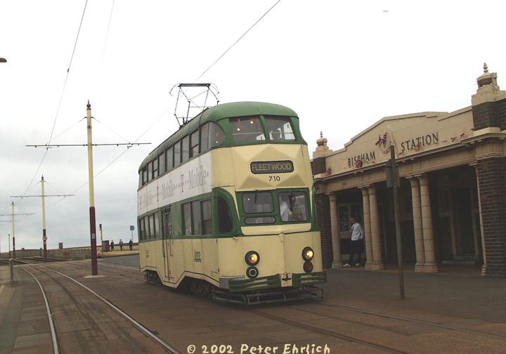 (106k, 720x504)<br><b>Country:</b> United Kingdom<br><b>City:</b> Blackpool<br><b>System:</b> Blackpool Transport<br><b>Car:</b> Blackpool Balloon (English Electric, 1934-1935)  710 <br><b>Photo by:</b> Peter Ehrlich<br><b>Date:</b> 6/30/2002<br><b>Notes:</b> A typical Blackpool tram--a double-decker Balloon, 710, heading northbound (toward Fleetwood) at Bispham Station.<br><b>Viewed (this week/total):</b> 1 / 2726