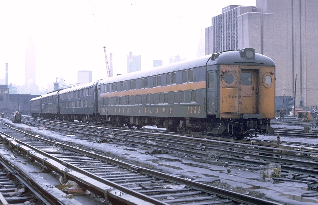 (189k, 1024x660)<br><b>Country:</b> United States<br><b>City:</b> New York<br><b>System:</b> Long Island Rail Road<br><b>Line:</b> LIRR Long Island City<br><b>Location:</b> Long Island City <br><b>Car:</b> LIRR MP70B  1302 <br><b>Photo by:</b> Doug Grotjahn<br><b>Collection of:</b> Joe Testagrose<br><b>Date:</b> 5/8/1971<br><b>Viewed (this week/total):</b> 1 / 3278