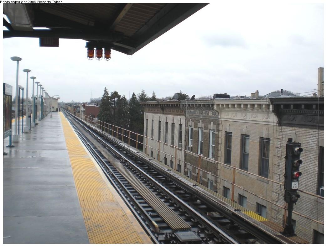 (225k, 1044x788)<br><b>Country:</b> United States<br><b>City:</b> New York<br><b>System:</b> New York City Transit<br><b>Line:</b> BMT Nassau Street/Jamaica Line<br><b>Location:</b> Crescent Street <br><b>Photo by:</b> Roberto C. Tobar<br><b>Date:</b> 4/11/2009<br><b>Notes:</b> Platform view.<br><b>Viewed (this week/total):</b> 1 / 919