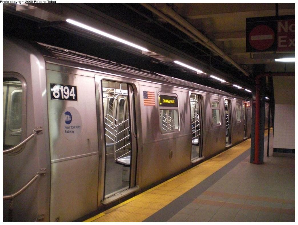 (252k, 1044x788)<br><b>Country:</b> United States<br><b>City:</b> New York<br><b>System:</b> New York City Transit<br><b>Line:</b> BMT Canarsie Line<br><b>Location:</b> Myrtle Avenue <br><b>Route:</b> L<br><b>Car:</b> R-143 (Kawasaki, 2001-2002) 8194 <br><b>Photo by:</b> Roberto C. Tobar<br><b>Date:</b> 4/11/2009<br><b>Viewed (this week/total):</b> 1 / 1658