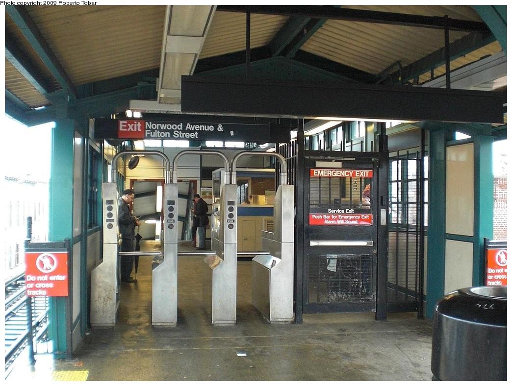 (285k, 1044x788)<br><b>Country:</b> United States<br><b>City:</b> New York<br><b>System:</b> New York City Transit<br><b>Line:</b> BMT Nassau Street/Jamaica Line<br><b>Location:</b> Norwood Avenue <br><b>Photo by:</b> Roberto C. Tobar<br><b>Date:</b> 4/11/2009<br><b>Notes:</b> Fare control on platform.<br><b>Viewed (this week/total):</b> 0 / 1371