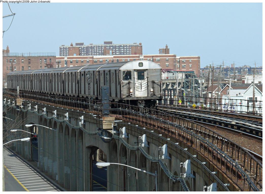 (318k, 1044x764)<br><b>Country:</b> United States<br><b>City:</b> New York<br><b>System:</b> New York City Transit<br><b>Line:</b> IND Rockaway<br><b>Location:</b> Beach 67th Street/Gaston Avenue <br><b>Route:</b> A<br><b>Car:</b> R-32 (Budd, 1964)  3828 <br><b>Photo by:</b> John Urbanski<br><b>Date:</b> 4/16/2009<br><b>Viewed (this week/total):</b> 3 / 1491