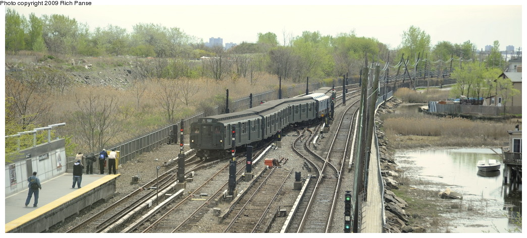 (175k, 1044x472)<br><b>Country:</b> United States<br><b>City:</b> New York<br><b>System:</b> New York City Transit<br><b>Line:</b> IND Rockaway<br><b>Location:</b> Howard Beach <br><b>Route:</b> Museum Train Service (A)<br><b>Car:</b> R-1 (American Car & Foundry, 1930-1931) 100 <br><b>Photo by:</b> Richard Panse<br><b>Date:</b> 4/29/2009<br><b>Viewed (this week/total):</b> 1 / 2821