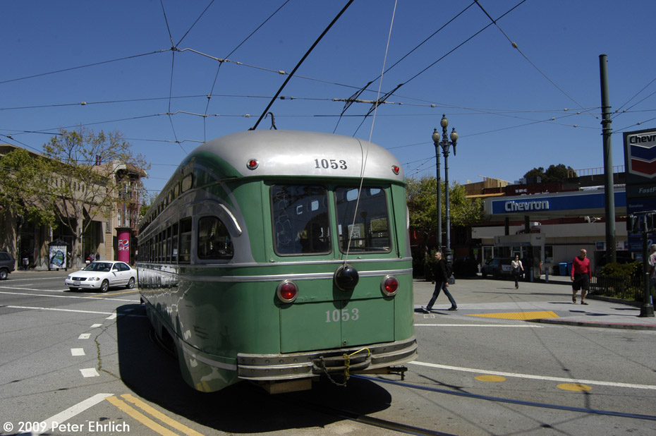 (190k, 930x618)<br><b>Country:</b> United States<br><b>City:</b> San Francisco/Bay Area, CA<br><b>System:</b> SF MUNI<br><b>Location:</b> Market/17th/Castro <br><b>Car:</b> SF MUNI PCC (Ex-SEPTA) (St. Louis Car Co., 1947-1948)  1053 <br><b>Photo by:</b> Peter Ehrlich<br><b>Date:</b> 4/4/2009<br><b>Notes:</b> Leaving 17th Street/Castro Terminal.<br><b>Viewed (this week/total):</b> 0 / 274