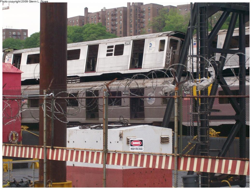 (252k, 1044x788)<br><b>Country:</b> United States<br><b>City:</b> New York<br><b>System:</b> New York City Transit<br><b>Location:</b> 207th Street Yard<br><b>Car:</b> R-38 (St. Louis, 1966-1967)  3993 <br><b>Photo by:</b> Glenn L. Rowe<br><b>Date:</b> 5/14/2009<br><b>Notes:</b> With R40 4303<br><b>Viewed (this week/total):</b> 1 / 990
