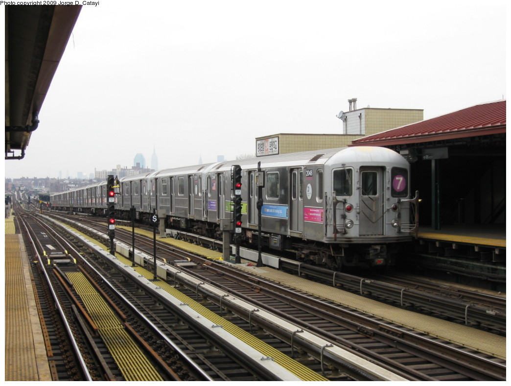 (193k, 1044x788)<br><b>Country:</b> United States<br><b>City:</b> New York<br><b>System:</b> New York City Transit<br><b>Line:</b> IRT Flushing Line<br><b>Location:</b> 74th Street/Broadway <br><b>Route:</b> 7<br><b>Car:</b> R-62A (Bombardier, 1984-1987)  2048 <br><b>Photo by:</b> Jorge Catayi<br><b>Date:</b> 3/15/2009<br><b>Viewed (this week/total):</b> 0 / 1120