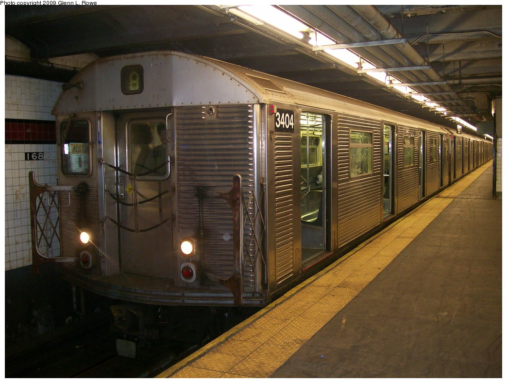 (214k, 1044x788)<br><b>Country:</b> United States<br><b>City:</b> New York<br><b>System:</b> New York City Transit<br><b>Line:</b> IND 8th Avenue Line<br><b>Location:</b> 168th Street <br><b>Route:</b> A<br><b>Car:</b> R-32 (Budd, 1964)  3404 <br><b>Photo by:</b> Glenn L. Rowe<br><b>Date:</b> 5/21/2009<br><b>Viewed (this week/total):</b> 2 / 1007