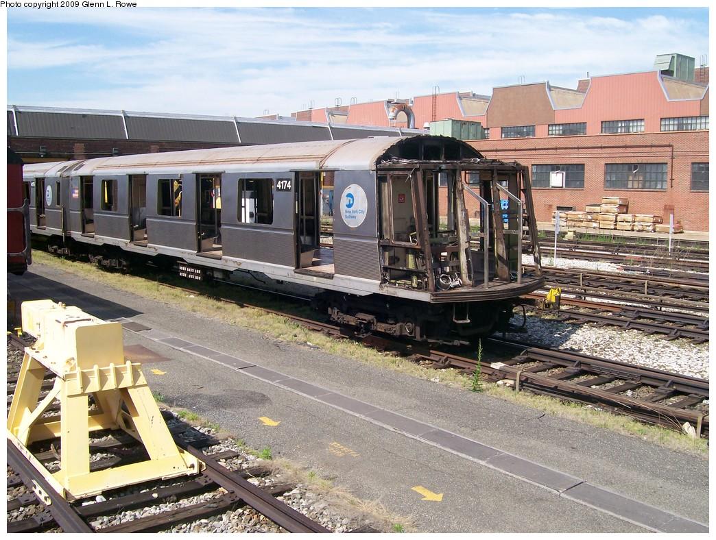 (288k, 1044x788)<br><b>Country:</b> United States<br><b>City:</b> New York<br><b>System:</b> New York City Transit<br><b>Location:</b> 207th Street Yard<br><b>Car:</b> R-40 (St. Louis, 1968)  4174 <br><b>Photo by:</b> Glenn L. Rowe<br><b>Date:</b> 5/22/2009<br><b>Notes:</b> Scrap<br><b>Viewed (this week/total):</b> 0 / 1104