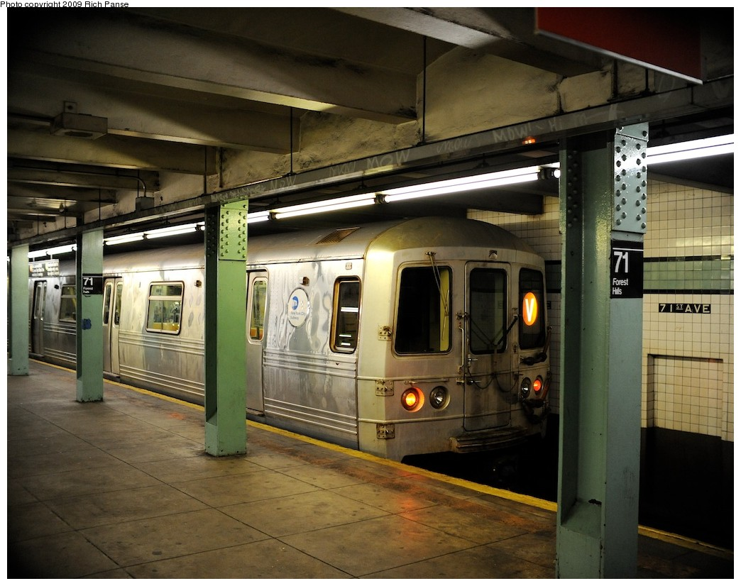(207k, 1044x826)<br><b>Country:</b> United States<br><b>City:</b> New York<br><b>System:</b> New York City Transit<br><b>Line:</b> IND Queens Boulevard Line<br><b>Location:</b> 71st/Continental Aves./Forest Hills <br><b>Route:</b> V<br><b>Car:</b> R-46 (Pullman-Standard, 1974-75)  <br><b>Photo by:</b> Richard Panse<br><b>Date:</b> 3/25/2009<br><b>Viewed (this week/total):</b> 3 / 1291