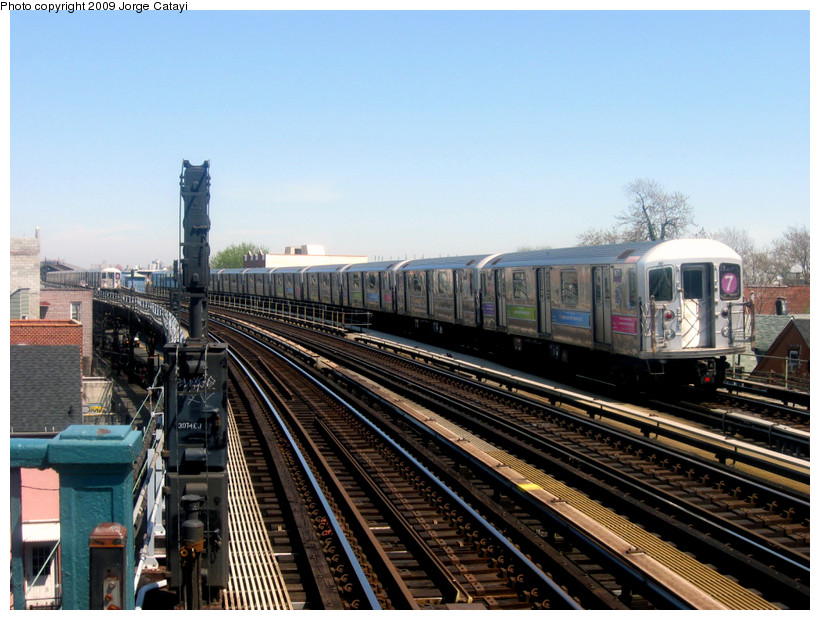 (193k, 820x620)<br><b>Country:</b> United States<br><b>City:</b> New York<br><b>System:</b> New York City Transit<br><b>Line:</b> IRT Flushing Line<br><b>Location:</b> 103rd Street/Corona Plaza <br><b>Route:</b> 7<br><b>Car:</b> R-62A (Bombardier, 1984-1987)  1671 <br><b>Photo by:</b> Jorge Catayi<br><b>Date:</b> 4/25/2009<br><b>Viewed (this week/total):</b> 1 / 1217