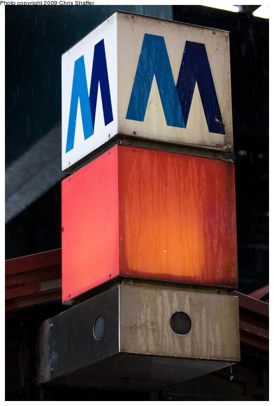 (115k, 553x820)<br><b>Country:</b> United States<br><b>City:</b> New York<br><b>System:</b> New York City Transit<br><b>Line:</b> IRT West Side Line<br><b>Location:</b> 238th Street <br><b>Photo by:</b> Chris C. Shaffer<br><b>Date:</b> 8/2/2008<br><b>Notes:</b> M logo at station entrance.<br><b>Viewed (this week/total):</b> 0 / 763