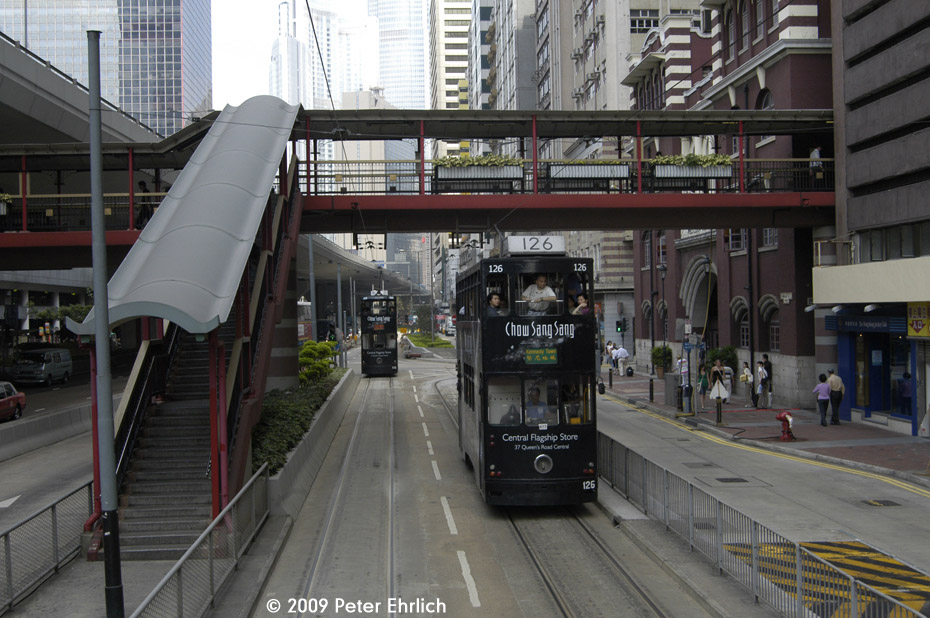 (215k, 930x618)<br><b>Country:</b> China (Hong Kong)<br><b>City:</b> Hong Kong<br><b>System:</b> Hong Kong Tramway Ltd.<br><b>Location:</b> Western Market Terminus (Sheung Wan) <br><b>Car:</b>  126 <br><b>Photo by:</b> Peter Ehrlich<br><b>Date:</b> 5/15/2009<br><b>Notes:</b> Inbound.  With 115 outbound.  Western Market is the red brick building beyond the footbridge.<br><b>Viewed (this week/total):</b> 1 / 658