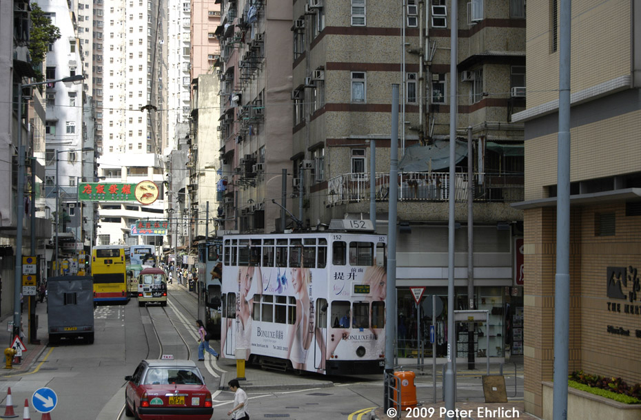 (242k, 930x610)<br><b>Country:</b> China (Hong Kong)<br><b>City:</b> Hong Kong<br><b>System:</b> Hong Kong Tramway Ltd.<br><b>Location:</b> Kennedy Town Terminus <br><b>Car:</b>  152 <br><b>Photo by:</b> Peter Ehrlich<br><b>Date:</b> 5/15/2009<br><b>Notes:</b> Leaving the last stop and beginning the Kennedy Town Loop.<br><b>Viewed (this week/total):</b> 0 / 545
