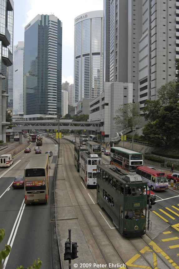 (204k, 574x864)<br><b>Country:</b> China (Hong Kong)<br><b>City:</b> Hong Kong<br><b>System:</b> Hong Kong Tramway Ltd.<br><b>Location:</b> Queensway/Cotton Tree <br><b>Car:</b>  31 <br><b>Photo by:</b> Peter Ehrlich<br><b>Date:</b> 5/15/2009<br><b>Notes:</b> 31 & 66 following, inbound.<br><b>Viewed (this week/total):</b> 0 / 413