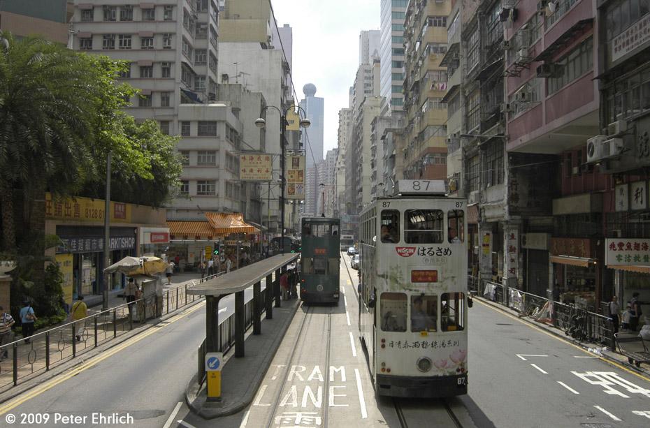 (225k, 930x613)<br><b>Country:</b> China (Hong Kong)<br><b>City:</b> Hong Kong<br><b>System:</b> Hong Kong Tramway Ltd.<br><b>Location:</b> Des Voeux Road West/Western <br><b>Car:</b>  87 <br><b>Photo by:</b> Peter Ehrlich<br><b>Date:</b> 5/15/2009<br><b>Notes:</b> West of Des Voeux Road West/Western, outbound.  With 108 inbound.<br><b>Viewed (this week/total):</b> 1 / 410