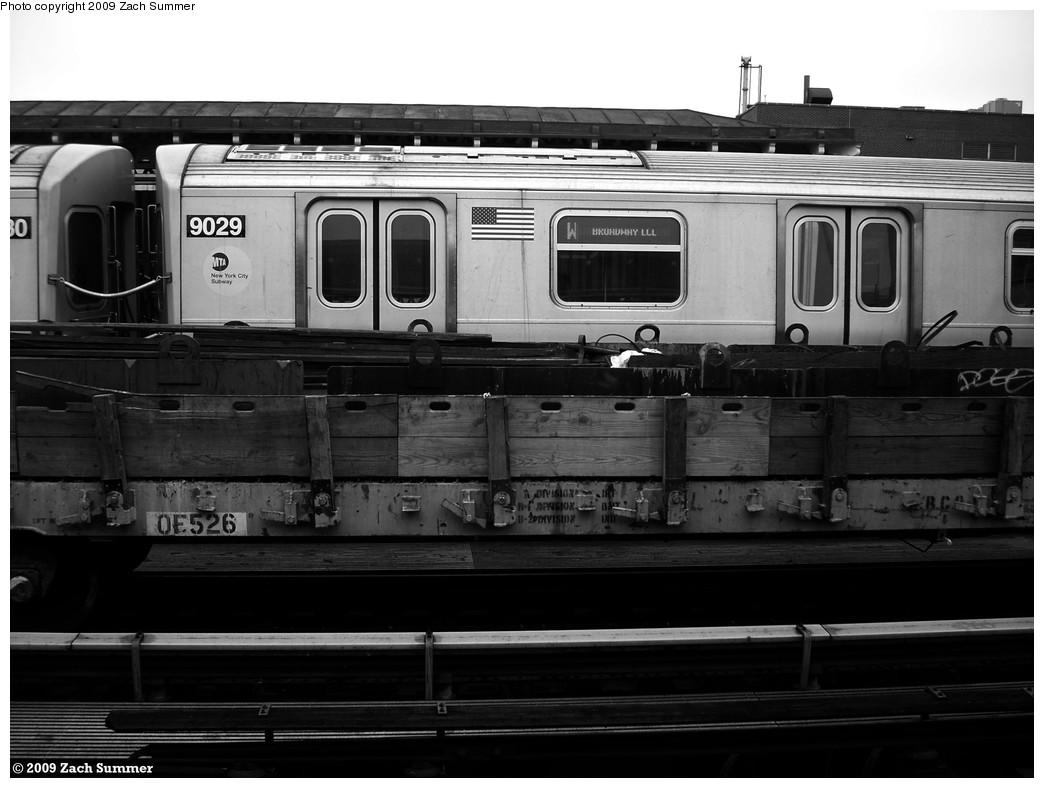 (171k, 1044x788)<br><b>Country:</b> United States<br><b>City:</b> New York<br><b>System:</b> New York City Transit<br><b>Line:</b> BMT Astoria Line<br><b>Location:</b> 30th/Grand Aves. <br><b>Route:</b> W<br><b>Car:</b> R-160B (Option 1) (Kawasaki, 2008-2009)  9029 <br><b>Photo by:</b> Zach Summer<br><b>Date:</b> 5/28/2009<br><b>Notes:</b> With Flat car OF526<br><b>Viewed (this week/total):</b> 0 / 1702