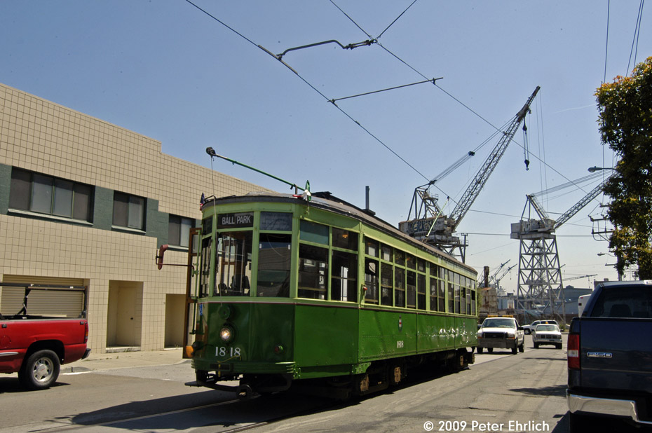 (194k, 930x618)<br><b>Country:</b> United States<br><b>City:</b> San Francisco/Bay Area, CA<br><b>System:</b> SF MUNI<br><b>Line:</b> MUNI 3rd Street Light Rail<br><b>Location:</b> 19th St. (Loop) <br><b>Car:</b> Milan Milano/Peter Witt (1927-1930)  1818 <br><b>Photo by:</b> Peter Ehrlich<br><b>Date:</b> 5/26/2009<br><b>Notes:</b> This is part of the unfinished Illinois Loop.  The cranes of the Union Iron Works Historic District are in the background.<br><b>Viewed (this week/total):</b> 0 / 847