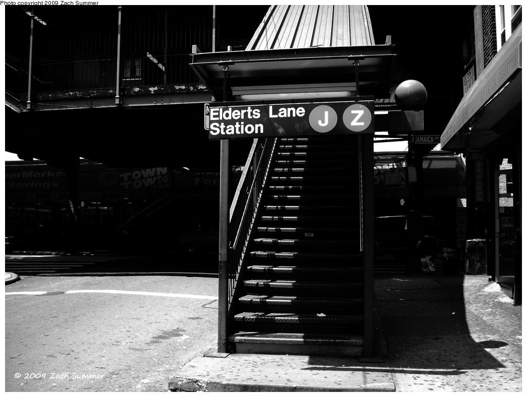 (196k, 1044x788)<br><b>Country:</b> United States<br><b>City:</b> New York<br><b>System:</b> New York City Transit<br><b>Line:</b> BMT Nassau Street/Jamaica Line<br><b>Location:</b> 75th Street/Elderts Lane <br><b>Photo by:</b> Zach Summer<br><b>Date:</b> 6/6/2009<br><b>Notes:</b> Station entrance.<br><b>Viewed (this week/total):</b> 0 / 1724