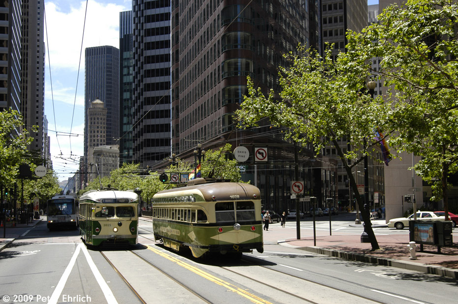 (302k, 930x618)<br><b>Country:</b> United States<br><b>City:</b> San Francisco/Bay Area, CA<br><b>System:</b> SF MUNI<br><b>Location:</b> Market/Beale/Davis <br><b>Car:</b> SF MUNI PCC Torpedo Double-End (St. Louis Car Co., 1948)  1015 <br><b>Photo by:</b> Peter Ehrlich<br><b>Date:</b> 6/6/2009<br><b>Notes:</b> Inbound. With 1078 (San Diego) outbound.<br><b>Viewed (this week/total):</b> 0 / 466