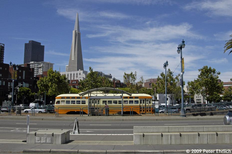 (200k, 930x618)<br><b>Country:</b> United States<br><b>City:</b> San Francisco/Bay Area, CA<br><b>System:</b> SF MUNI<br><b>Location:</b> Embarcadero/Broadway <br><b>Car:</b> SF MUNI PCC (Ex-NJTransit, Ex-Twin City) (St. Louis Car Co., 1946-1947)  1075 <br><b>Photo by:</b> Peter Ehrlich<br><b>Date:</b> 6/19/2009<br><b>Notes:</b> Inbound.<br><b>Viewed (this week/total):</b> 0 / 501