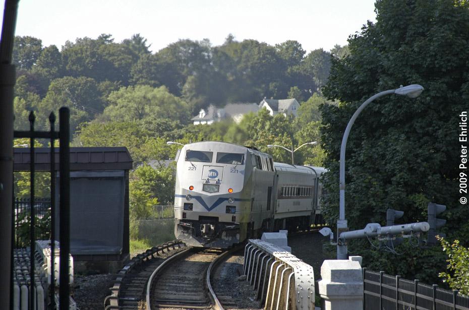 (221k, 930x615)<br><b>Country:</b> United States<br><b>System:</b> Metro-North Railroad (or Amtrak or Predecessor RR)<br><b>Line:</b> Metro North-Harlem Line<br><b>Location:</b> White Plains <br><b>Car:</b> MNRR GE Genesis P-32AC-DM 221 <br><b>Photo by:</b> Peter Ehrlich<br><b>Date:</b> 8/1/2009<br><b>Notes:</b> Inbound<br><b>Viewed (this week/total):</b> 0 / 626
