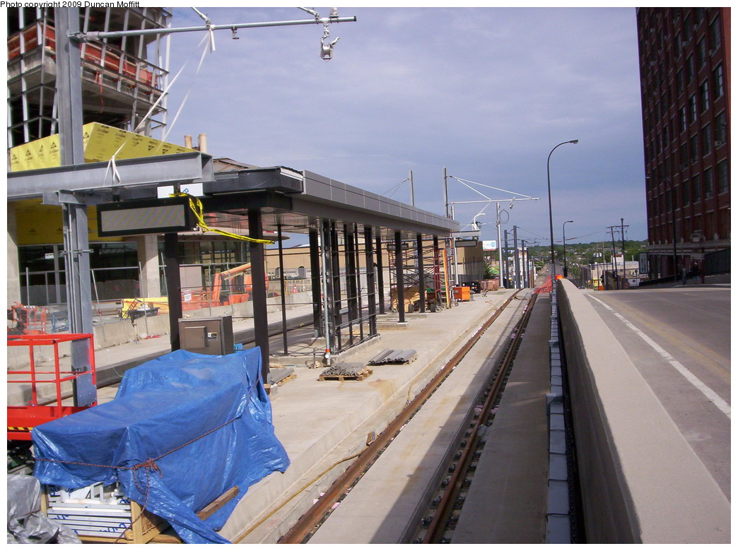 (248k, 1044x780)<br><b>Country:</b> United States<br><b>City:</b> Minneapolis, MN<br><b>System:</b> MNDOT Light Rail Transit<br><b>Line:</b> Hiawatha Line<br><b>Location:</b> <b>Downtown Minneapolis Ballpark</b> <br><b>Photo by:</b> Duncan Moffitt<br><b>Date:</b> 5/25/2009<br><b>Notes:</b> Looking northwestward along N. 5th St. in May as construction progresses. The digital signs have been mounted and pulleys for stringing the wire are in place.<br><b>Viewed (this week/total):</b> 0 / 588
