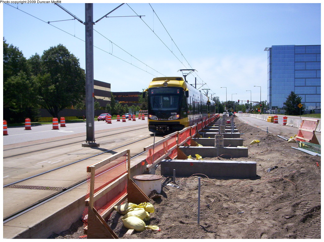 (275k, 1044x780)<br><b>Country:</b> United States<br><b>City:</b> Minneapolis, MN<br><b>System:</b> MNDOT Light Rail Transit<br><b>Line:</b> Hiawatha Line<br><b>Location:</b> 34th Avenue/American Blvd. <br><b>Photo by:</b> Duncan Moffitt<br><b>Date:</b> 7/11/2009<br><b>Notes:</b> Looking south along 34th Ave. S. at American Boulevard, formerly E. 80th St., where a new station is being built. The beginnings of the souththbound platform are directly across the tracks from the northbound left turn lane.<br><b>Viewed (this week/total):</b> 0 / 665