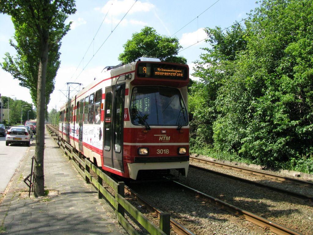 (207k, 1024x768)<br><b>Country:</b> The Netherlands<br><b>City:</b> The Hague<br><b>System:</b> HTM (Haagsche Tramweg Maatschappij) <br><b>Location:</b> Erasmusweg <br><b>Route:</b> 9<br><b>Car:</b> HTM GLT-8-1  3018  <br><b>Photo by:</b> Jos Straathof<br><b>Date:</b> 5/23/2009<br><b>Viewed (this week/total):</b> 1 / 318
