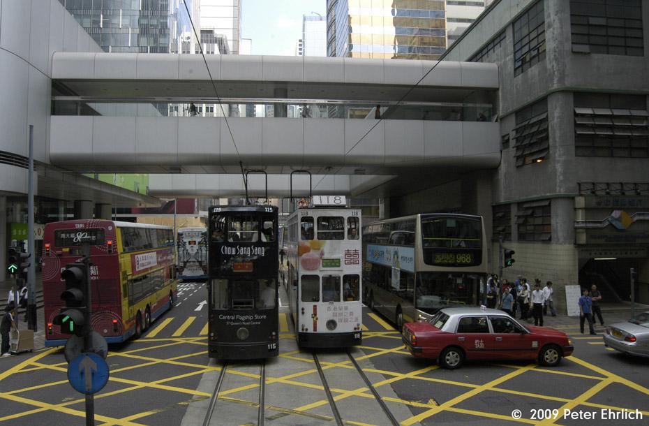(200k, 930x610)<br><b>Country:</b> China (Hong Kong)<br><b>City:</b> Hong Kong<br><b>System:</b> Hong Kong Tramway Ltd.<br><b>Location:</b> Des Voeux Road <br><b>Car:</b>  115/118 <br><b>Photo by:</b> Peter Ehrlich<br><b>Date:</b> 5/15/2009<br><b>Notes:</b> Des Voeux Road Central outbound, exact location unknown.  With 118 inbound.<br><b>Viewed (this week/total):</b> 1 / 608