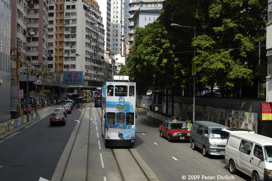 (247k, 930x618)<br><b>Country:</b> China (Hong Kong)<br><b>City:</b> Hong Kong<br><b>System:</b> Hong Kong Tramway Ltd.<br><b>Location:</b> Des Voeux Road <br><b>Car:</b>  72 <br><b>Photo by:</b> Peter Ehrlich<br><b>Date:</b> 5/15/2009<br><b>Notes:</b> Inbound trams on Des Voeux Road West, east of Whitty Street Loop, exact location unknown.<br><b>Viewed (this week/total):</b> 0 / 551