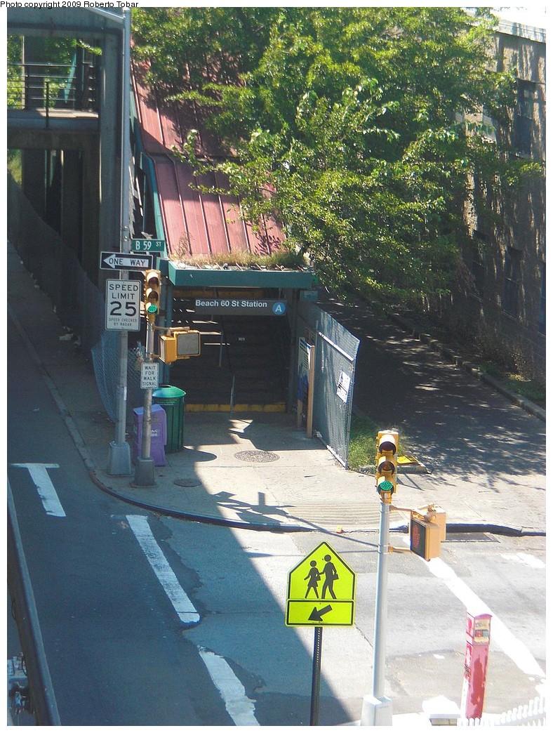 (312k, 788x1044)<br><b>Country:</b> United States<br><b>City:</b> New York<br><b>System:</b> New York City Transit<br><b>Line:</b> IND Rockaway<br><b>Location:</b> Beach 60th Street/Straiton <br><b>Photo by:</b> Roberto C. Tobar<br><b>Date:</b> 8/21/2009<br><b>Notes:</b> Station entrance.<br><b>Viewed (this week/total):</b> 3 / 1388