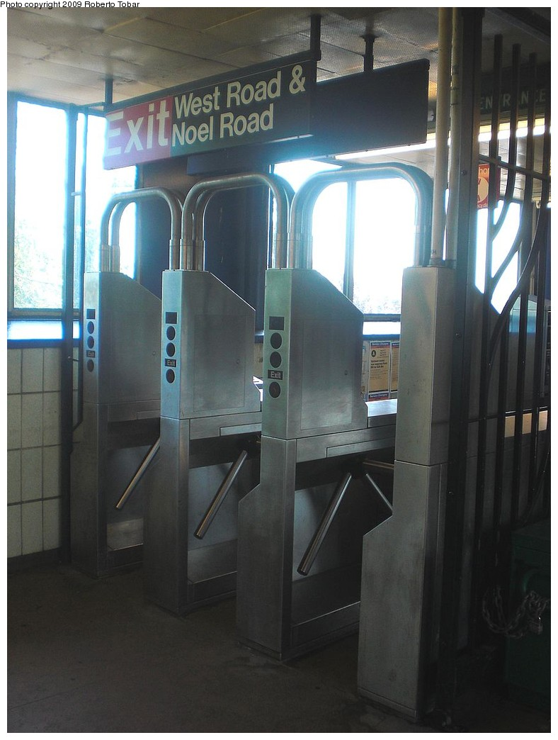 (202k, 788x1044)<br><b>Country:</b> United States<br><b>City:</b> New York<br><b>System:</b> New York City Transit<br><b>Line:</b> IND Rockaway<br><b>Location:</b> Broad Channel <br><b>Photo by:</b> Roberto C. Tobar<br><b>Date:</b> 8/21/2009<br><b>Notes:</b> Turnstiles/exit to West Rd.<br><b>Viewed (this week/total):</b> 2 / 1042