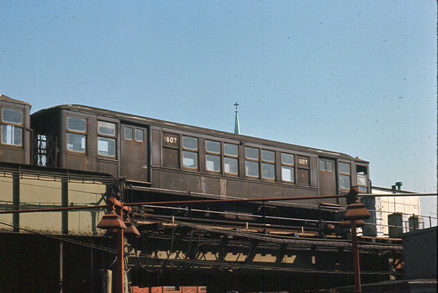 (255k, 877x586)<br><b>Country:</b> United States<br><b>City:</b> New York<br><b>System:</b> New York City Transit<br><b>Line:</b> BMT Myrtle Avenue Line<br><b>Location:</b> Broadway/Myrtle Avenue (Upper Level) <br><b>Car:</b> BMT Q 1607 <br><b>Photo by:</b> Brian J. Cudahy<br><b>Date:</b> 1963<br><b>Notes:</b> circa 1963<br><b>Viewed (this week/total):</b> 4 / 3279