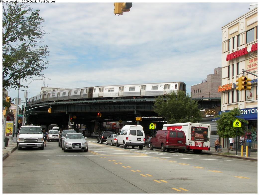 (275k, 1044x788)<br><b>Country:</b> United States<br><b>City:</b> New York<br><b>System:</b> New York City Transit<br><b>Line:</b> BMT Brighton Line<br><b>Location:</b> Brighton Beach <br><b>Route:</b> Q<br><b>Car:</b> R-68 (Westinghouse-Amrail, 1986-1988)   <br><b>Photo by:</b> David-Paul Gerber<br><b>Date:</b> 9/4/2009<br><b>Notes:</b> View from Br. Beach Ave & Br. 11th St.<br><b>Viewed (this week/total):</b> 0 / 1499