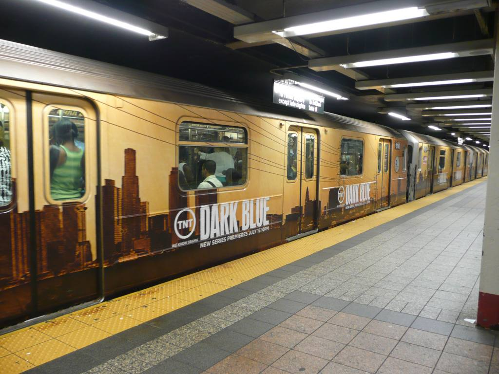 (135k, 1024x768)<br><b>Country:</b> United States<br><b>City:</b> New York<br><b>System:</b> New York City Transit<br><b>Line:</b> IRT Times Square-Grand Central Shuttle<br><b>Location:</b> Grand Central <br><b>Photo by:</b> Robbie Rosenfeld<br><b>Date:</b> 7/16/2009<br><b>Notes:</b> Shuttle ad wrap for tv show Dark Blue.<br><b>Viewed (this week/total):</b> 4 / 1118