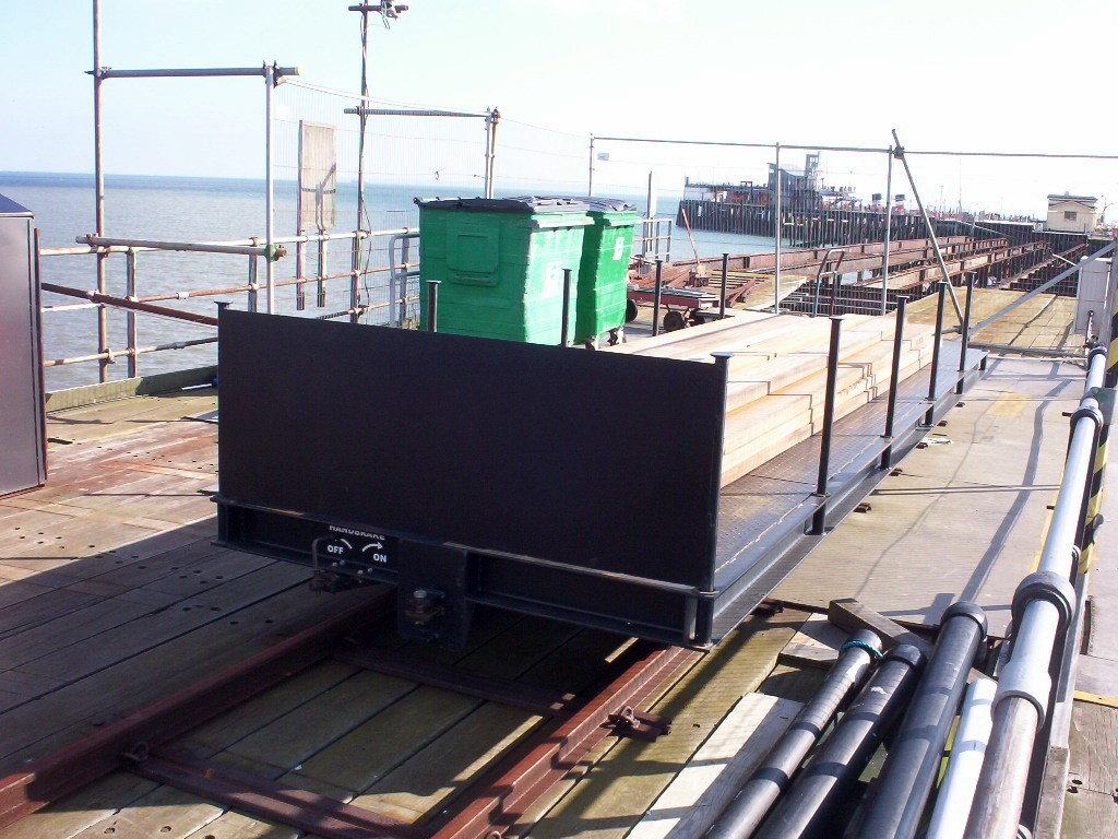 (239k, 1024x768)<br><b>Country:</b> United Kingdom<br><b>City:</b> Southend-on-Sea, Essex<br><b>System:</b> Southend Pier Railway<br><b>Photo by:</b> Dave Carson<br><b>Date:</b> 10/6/2007<br><b>Notes:</b> Newly delivered bogie flat car at the old Pier Head Station site (officially known as South Station). The previous flat car was a glass fibre vehicle which melted without trace in the October 2005 fire.<br><b>Viewed (this week/total):</b> 2 / 659