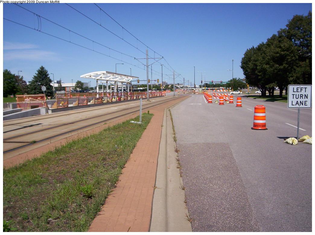 (265k, 1044x780)<br><b>Country:</b> United States<br><b>City:</b> Minneapolis, MN<br><b>System:</b> MNDOT Light Rail Transit<br><b>Line:</b> Hiawatha Line<br><b>Location:</b> 34th Avenue/American Blvd. <br><b>Photo by:</b> Duncan Moffitt<br><b>Date:</b> 8/22/2009<br><b>Notes:</b> Looking northward along 34th Ave. S., now showing the framing for the platform shelters.<br><b>Viewed (this week/total):</b> 0 / 526