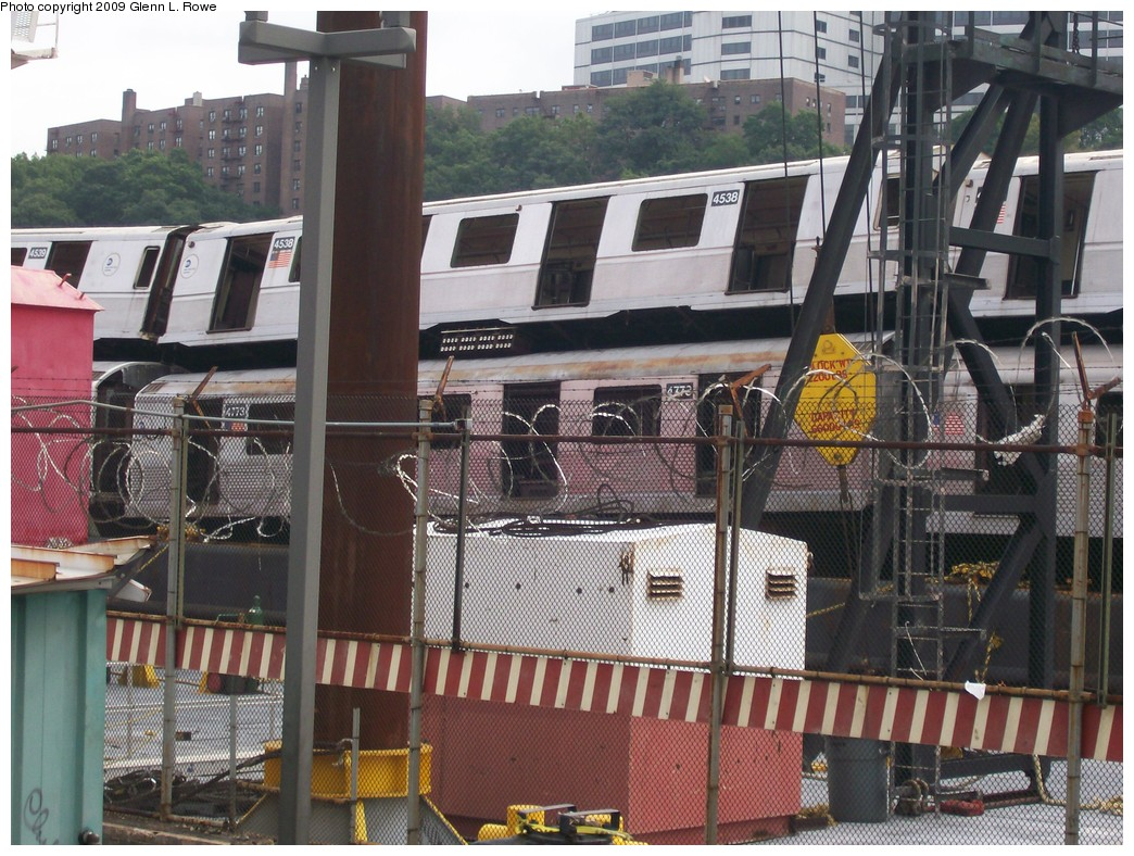 (261k, 1044x788)<br><b>Country:</b> United States<br><b>City:</b> New York<br><b>System:</b> New York City Transit<br><b>Location:</b> 207th Street Yard<br><b>Car:</b> R-40M (St. Louis, 1969)  4538 w/4773 <br><b>Photo by:</b> Glenn L. Rowe<br><b>Date:</b> 9/23/2009<br><b>Notes:</b> Barge-Scrapping<br><b>Viewed (this week/total):</b> 0 / 1071