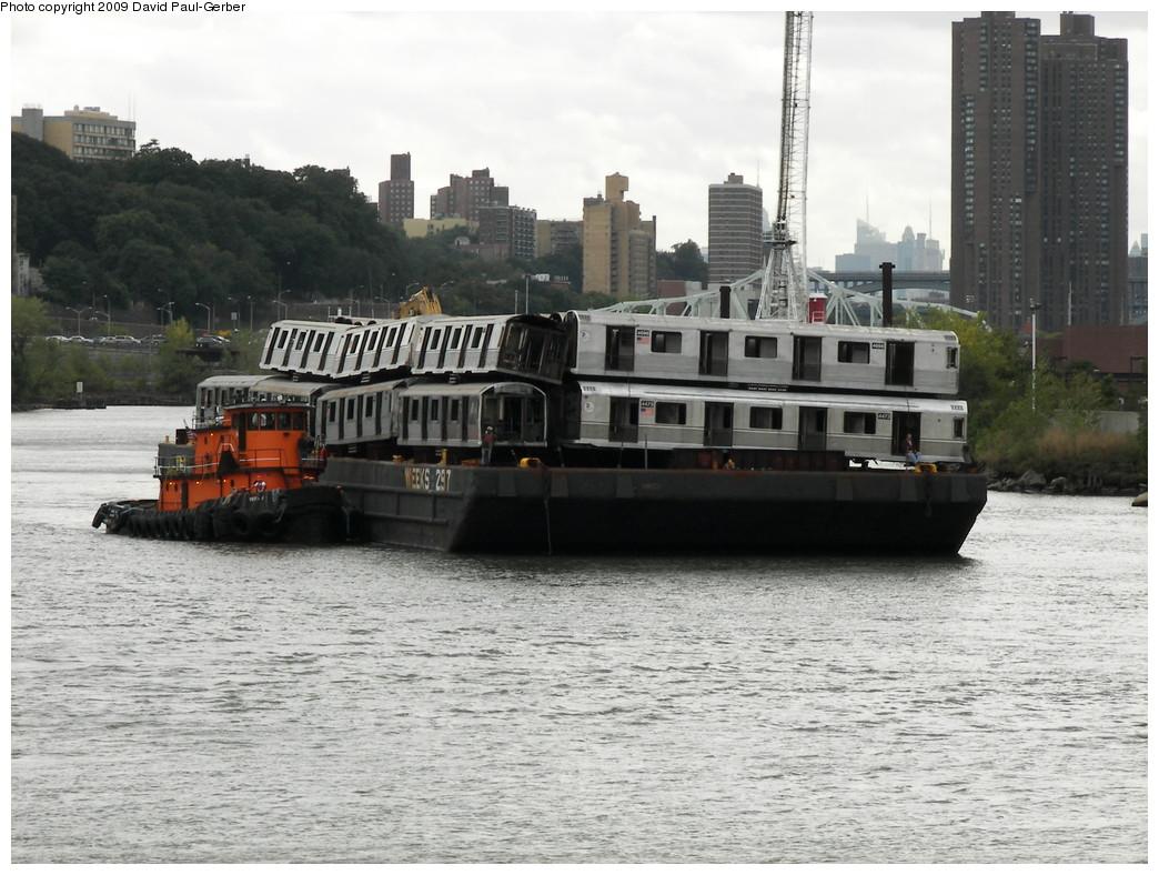 (274k, 1044x788)<br><b>Country:</b> United States<br><b>City:</b> New York<br><b>System:</b> New York City Transit<br><b>Location:</b> 207th Street Yard<br><b>Car:</b> R-40M (St. Louis, 1969)  4473 <br><b>Photo by:</b> David-Paul Gerber<br><b>Date:</b> 9/26/2009<br><b>Notes:</b> Barge-Scrapping<br><b>Viewed (this week/total):</b> 0 / 1323