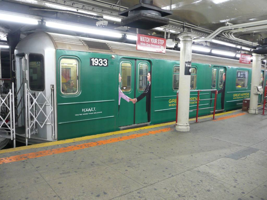 (132k, 1024x768)<br><b>Country:</b> United States<br><b>City:</b> New York<br><b>System:</b> New York City Transit<br><b>Line:</b> IRT Times Square-Grand Central Shuttle<br><b>Location:</b> Times Square <br><b>Route:</b> S<br><b>Car:</b> R-62A (Bombardier, 1984-1987)  1933 <br><b>Photo by:</b> Robbie Rosenfeld<br><b>Date:</b> 10/6/2009<br><b>Notes:</b> Hyatt hotels wrap.<br><b>Viewed (this week/total):</b> 0 / 1983