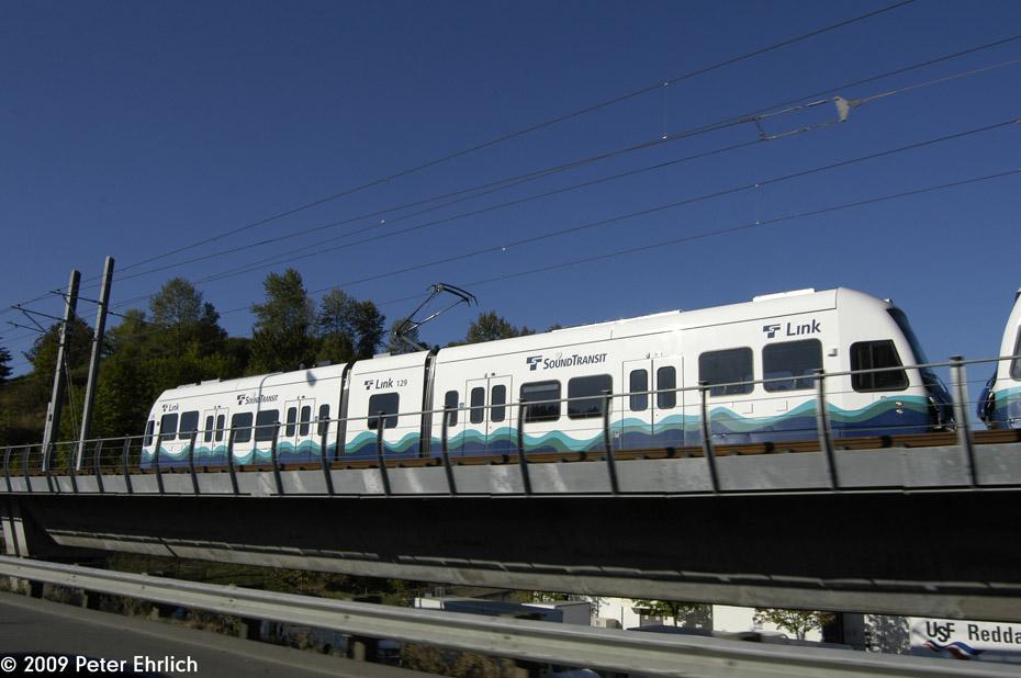 (160k, 930x618)<br><b>Country:</b> United States<br><b>City:</b> Seattle, WA<br><b>System:</b> Sound Transit LINK Light Rail<br><b>Location:</b> <b>Rainier Beach</b> <br><b>Car:</b> SeattleLink LRV (Kinki-Sharyo, 2006-2009)  129 <br><b>Photo by:</b> Peter Ehrlich<br><b>Date:</b> 9/11/2009<br><b>Notes:</b> Outbound; along I-5 Freeway.<br><b>Viewed (this week/total):</b> 2 / 896
