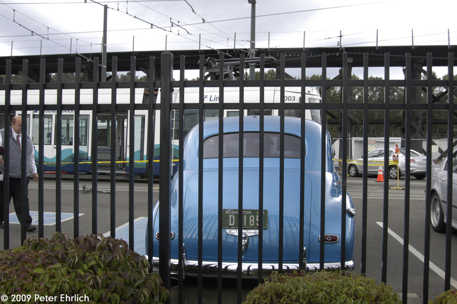 (215k, 930x618)<br><b>Country:</b> United States<br><b>City:</b> Tacoma, WA<br><b>System:</b> SoundTransit - Tacoma Link Light Rail<br><b>Location:</b> Tacoma Link Maint. Facility (25th & G)<br><b>Car:</b> Škoda/Inekon Astra 10T 1003 <br><b>Photo by:</b> Peter Ehrlich<br><b>Date:</b> 9/16/2009<br><b>Notes:</b> Note 1941 Chevy in yard.<br><b>Viewed (this week/total):</b> 0 / 1079