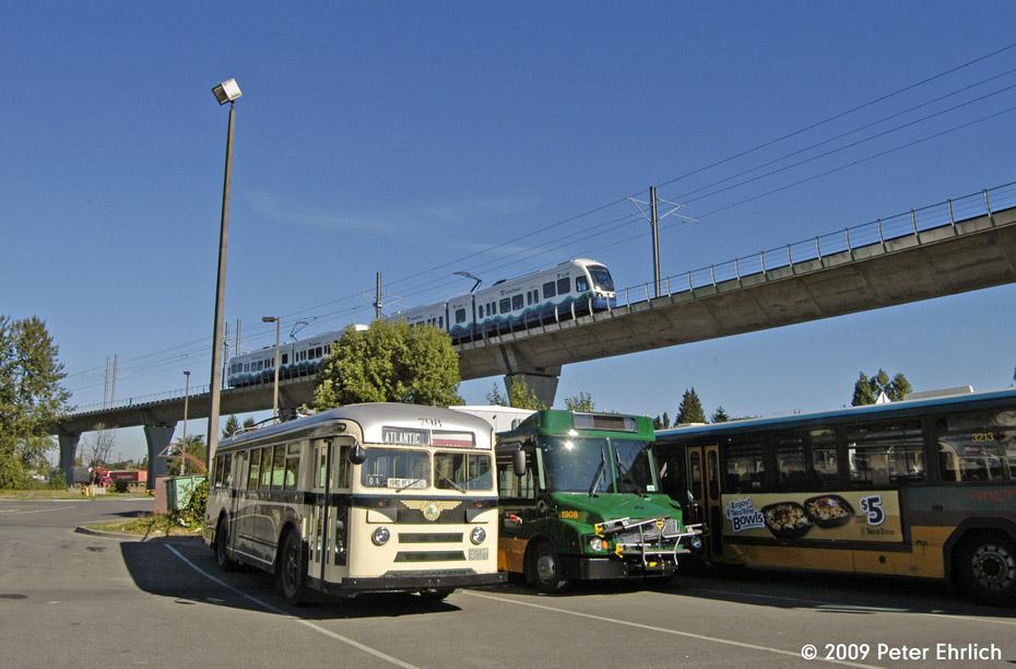(181k, 930x612)<br><b>Country:</b> United States<br><b>City:</b> Seattle, WA<br><b>System:</b> Sound Transit LINK Light Rail<br><b>Location:</b> King County Metro South Base <br><b>Car:</b> SeattleLink LRV (Kinki-Sharyo, 2006-2009)  134 <br><b>Photo by:</b> Peter Ehrlich<br><b>Date:</b> 9/11/2009<br><b>Notes:</b> Outbound. Passing over King County Metro South Base, with Brill trolley coach 798 in the yard, awaiting restoration work.<br><b>Viewed (this week/total):</b> 1 / 962