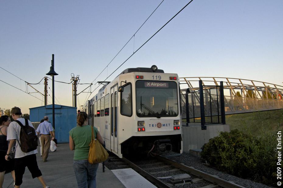(174k, 930x618)<br><b>Country:</b> United States<br><b>City:</b> Portland, OR<br><b>System:</b> Portland MAX<br><b>Line:</b> MAX Red (Airport) Line<br><b>Location:</b> Parkrose/Sumner Transit Center <br><b>Car:</b> MAX Type 1 (Bombardier)  119 <br><b>Photo by:</b> Peter Ehrlich<br><b>Date:</b> 9/11/2009<br><b>Notes:</b> Outbound.<br><b>Viewed (this week/total):</b> 0 / 793