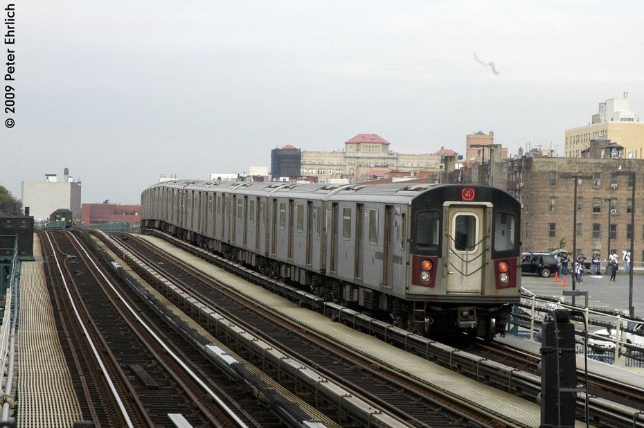 (207k, 930x618)<br><b>Country:</b> United States<br><b>City:</b> New York<br><b>System:</b> New York City Transit<br><b>Line:</b> IRT Woodlawn Line<br><b>Location:</b> 161st Street/River Avenue (Yankee Stadium) <br><b>Route:</b> 4<br><b>Car:</b> R-142 (Option Order, Bombardier, 2002-2003)  1165 <br><b>Photo by:</b> Peter Ehrlich<br><b>Date:</b> 10/9/2009<br><b>Notes:</b> Outbound. Trailing view.  Lo-V 4292 is in the background on the center track.<br><b>Viewed (this week/total):</b> 0 / 1094