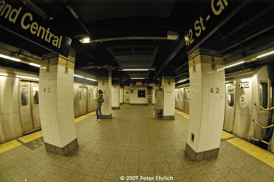 (227k, 930x618)<br><b>Country:</b> United States<br><b>City:</b> New York<br><b>System:</b> New York City Transit<br><b>Line:</b> IRT East Side Line<br><b>Location:</b> Grand Central <br><b>Car:</b> R-142 (Primary Order, Bombardier, 1999-2002)  6458 <br><b>Photo by:</b> Peter Ehrlich<br><b>Date:</b> 10/9/2009<br><b>Notes:</b> Express on left.  With 7400 on 6 Line on right.  Fisheye view.<br><b>Viewed (this week/total):</b> 0 / 1144